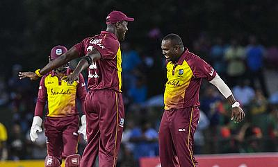 Carlos Brathwaite and Ashley Nurse celebrate the fall of a wicket