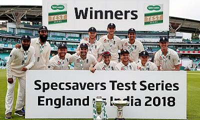 England players pose for a photo as they celebrate with trophies after the match