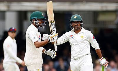 Pakistan's Babar Azam (L) celebrates with Sarfraz Ahmed after reaching a half century