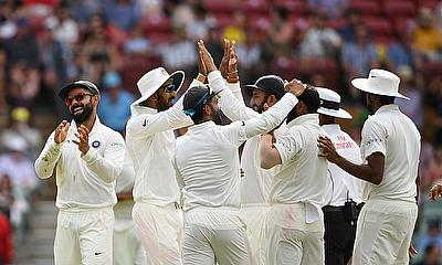 India's captain Virat Kohli  reacts with teammates