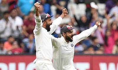 India's Pujara and Kohli celebrate