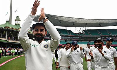 India's captain Virat Kohli gestures to supporters