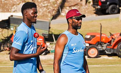 Fast bowler Alzarri Joseph with bowling coach, Corey Collymore
