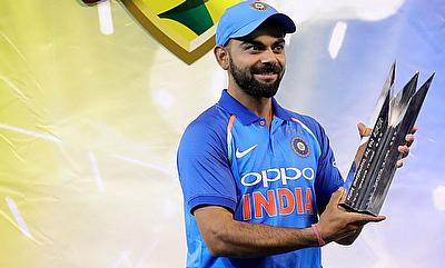 India's captain Virat Kohli holds the trophy after winning the third one-day