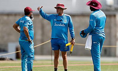 West Indies' Head Coach Richard Pybus talks with bowling coach Mushtaq Ahmed