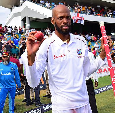 Roston Chase celebrates as Windies complete victory by 381 runs.
