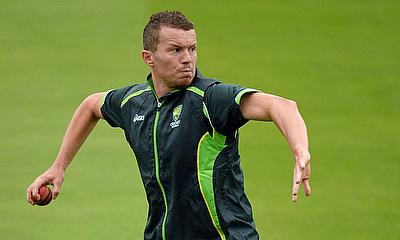 Peter Siddle throws a ball during a training sessio