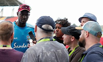 Jason Holder talks to the media