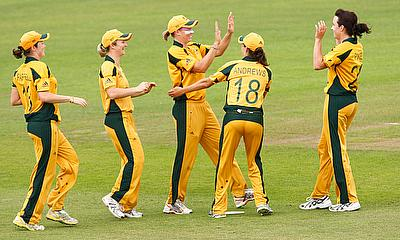 Australia's Kirsten Pike (R) celebrates with team mates after taking a wicket