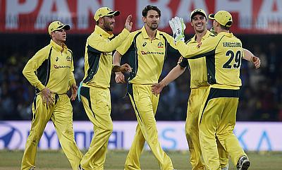 Australia's Kane Richardson (C) celebrates with his team mates