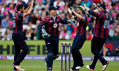 Northamptonshire's Ben Sanderson (left) celebrates a wicket