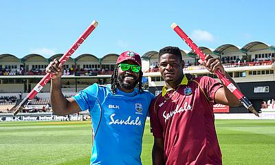 Chris Gayle and Oshane Thomas celebrate Windies victory.