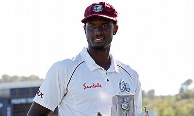 Jason Holder with the Wisden Trophy