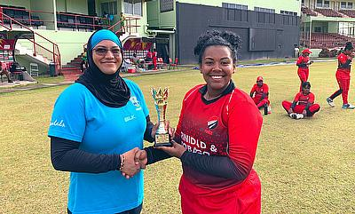 Reniece Boyce receiving award from Naasira Mohammed