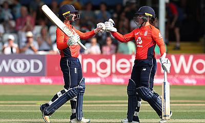Danielle Wyatt celebrates with Tammy Beaumont