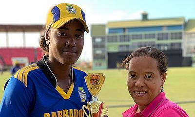 Hayley Matthews receiving her Player of the Match award from CWI's Josina Luke