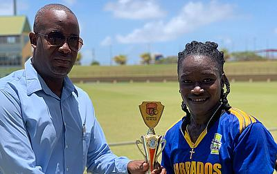 Deandra Dottin receiving her Player of the Match award from Arliegh Rutherford