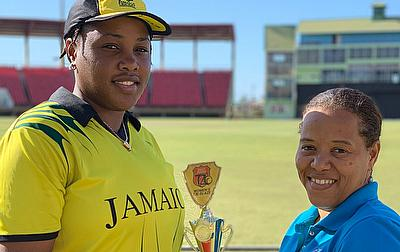 Neisha Ann Waisome receiving her Player of the Match award from CWI's Josina Luke