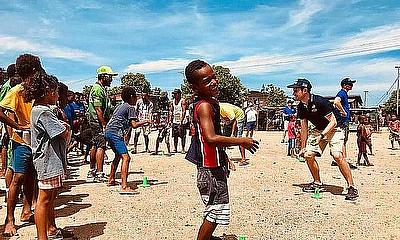 Cricket being played in Hanuabada village Papua New Guinea