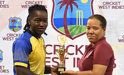 Deandra Dottin receiving her Player of the Match award from CWI's Josina Luke