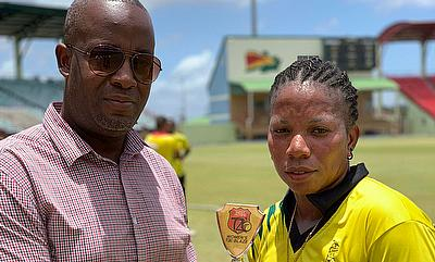 Chedean Nation receiving her Player of the Match award from Arliegh Rutherford