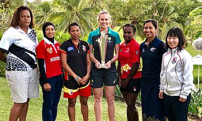 Holly Ferling with EAP captains and Women's T20 World Cup Trophy