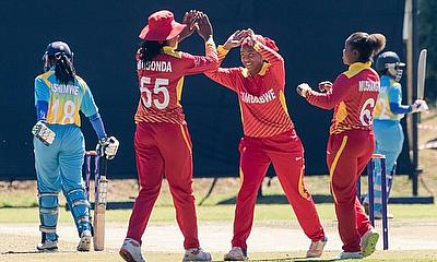 Zimbabwe players celebrate one of Tasmeen Grangers three wickets