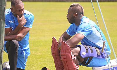 Head Coach, Floyd Reifer, speaks to allrounder Andre Russell ahead of today's net session