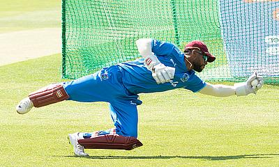 Shai Hope take low catches during the fielding session.