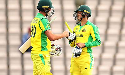 Australia's Alex Carey and Pat Cummins celebrate at the end of the match