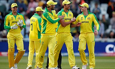 Australia's Nathan Coulter-Nile celebrates with Steve Smith and team mates at the end of the match