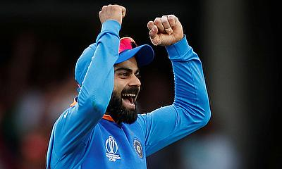Virat Kohli celebrates after India win the match