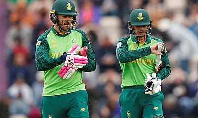 South Africa's Faf du Plessis and Quinton de Kock walk off the field as rain stop