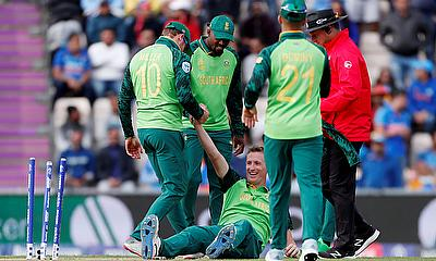 South Africa's Chris Morris celebrates with team mates after taking the wicket of India's MS Dhoni