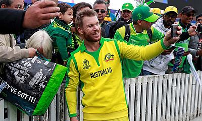 Australia's David Warner poses for a photo with fans after the match
