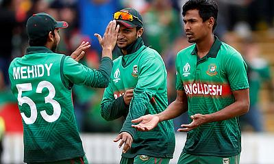 Bangladesh's Mustafizur Rahman celebrates the wicket of West Indies Andre Russell