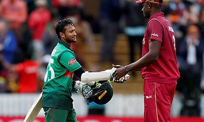 Bangladesh's Shakib Al Hasan shakes hands with West Indies' captain Jason Holder at the end