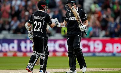 New Zealand's Kane Williamson celebrates with Mitchell Santner after the match