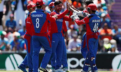 Afghanistan's Rashid Khan celebrates taking the wicket of India's MS Dhoni