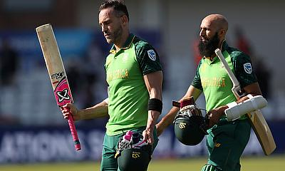 South Africa's Faf du Plessis and Hashim Amla walk off after winning the match