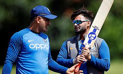 India's MS Dhoni (L) and Rishabh Pant during nets