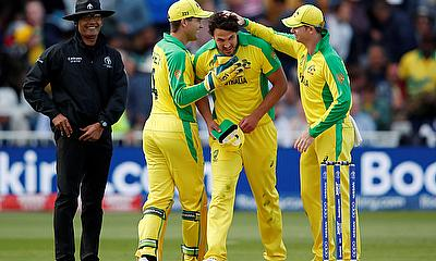 Australia's Nathan Coulter-Nile celebrates with Steve Smith and Alex Carey at the end of the match