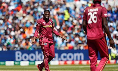 West Indies' Sheldon Cottrell reacts as Carlos Brathwaite looks on