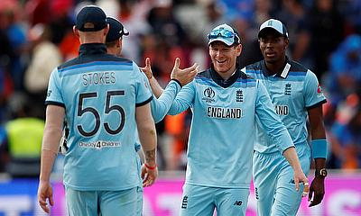 England's Eoin Morgan celebrates with team mates after the match