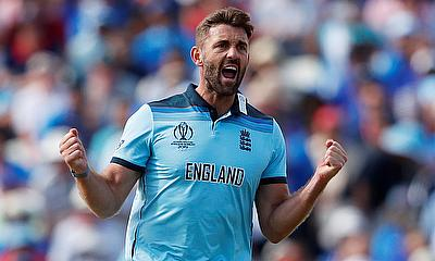 England's Liam Plunkett celebrates taking the wicket of India's Virat Kohli