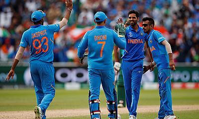 India's Bhuvneshwar Kumar celebrates with team mates after taking the wicket of Bangladesh's Mashrafe Mortaza