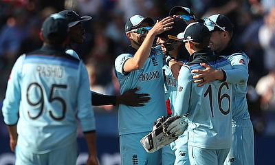 England's Jos Buttler celebrates with team mates after stumping New Zealand's Trent Boult