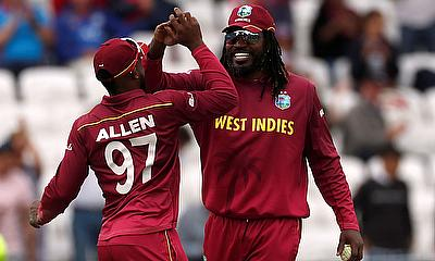 West Indies' Fabian Allen and Chris Gayle celebrate after the match