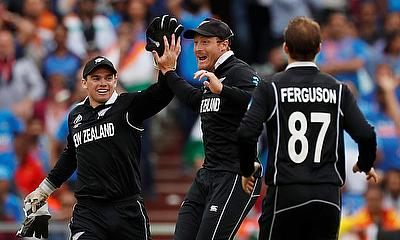 New Zealand's Martin Guptill celebrates with team mates after taking the wicket of India's MS Dhoni