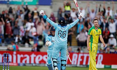 England's Eoin Morgan and Joe Root celebrate after the match